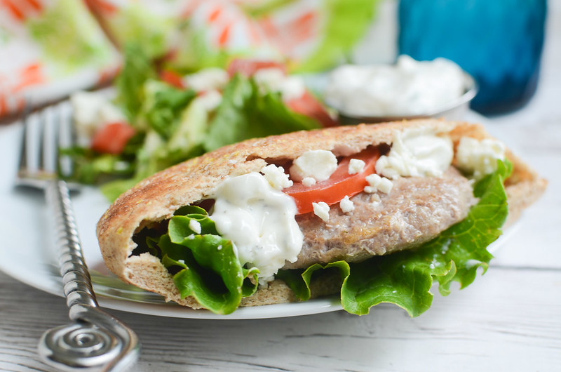 Greek Turkey Burgers - delicious burgers in pitas with feta and homemade tzatziki sauce! Plus, the best tips for keeping turkey burgers from drying out!