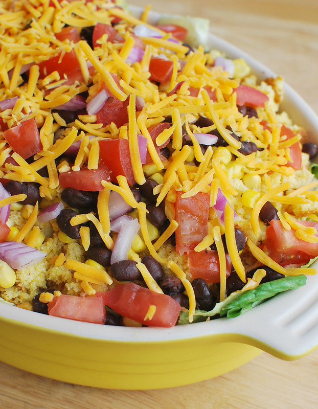 Southwestern Cornbread Salad - layers of lettuce, black beans, corn, tomatoes, red onion, cheese, and cornbread in a zesty dressing! Perfect for barbecues!