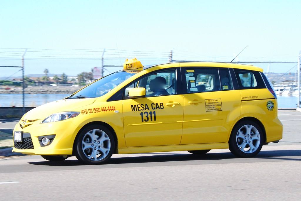 Mazda San Diego >> Yellow Cab   One of the few Mazda cabs I've seen, and ...