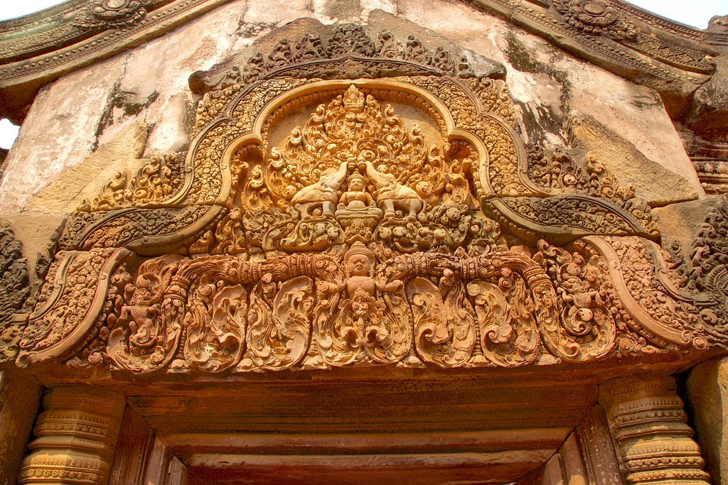 Stone carvings at the entrance to banteay srei temple near