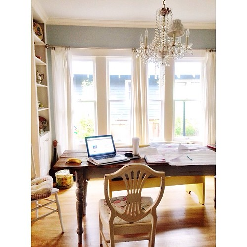 It's a rare day when I have the house all to myself. Today I'm working in the dining room and loving every minute of these last few weeks here. I think we will take the chandelier with us when we move! Also, note the giant cup of tea, and giant papers. It