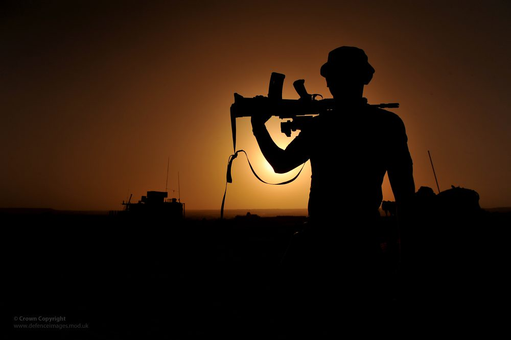 Soldier Silhouetted In Afghanistan A Soldier With 1
