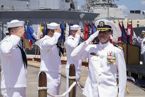 PEARL HARBOR, Hawaii – Cdr. Colby W. Sherwood relieved Cdr. Gina L. McCaine as commanding officer aboard the guided missile destroyer USS O'Kane (DDG 77) during a change of command ceremony June 30th.