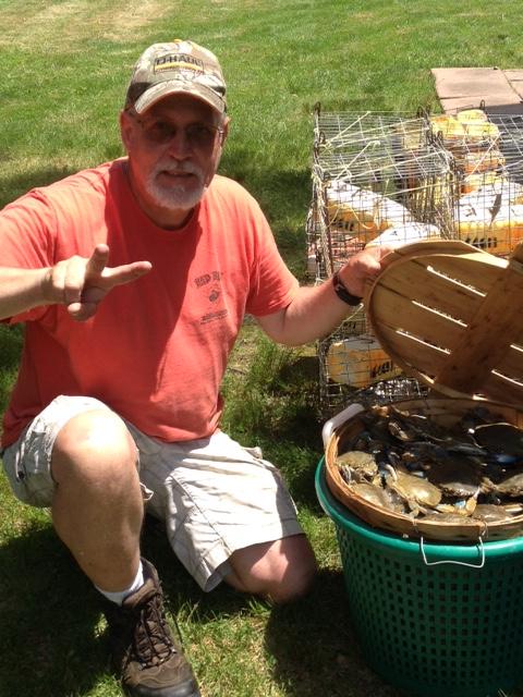 A man with a bushel of crabs.