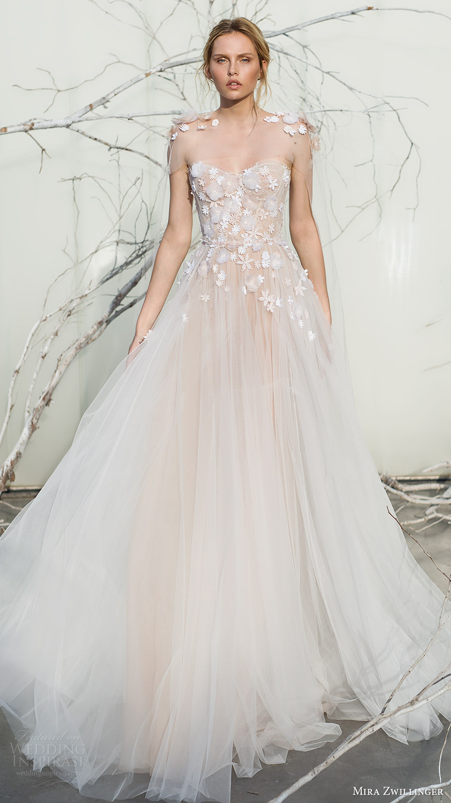 Whisper of blossom bridal collection 2017 mira zwillinger the gowns with light as air appearance are exquisitely feminine with their sequined clusters silk petals and sheath silhouettes float into the magic of ombrellifo Gallery