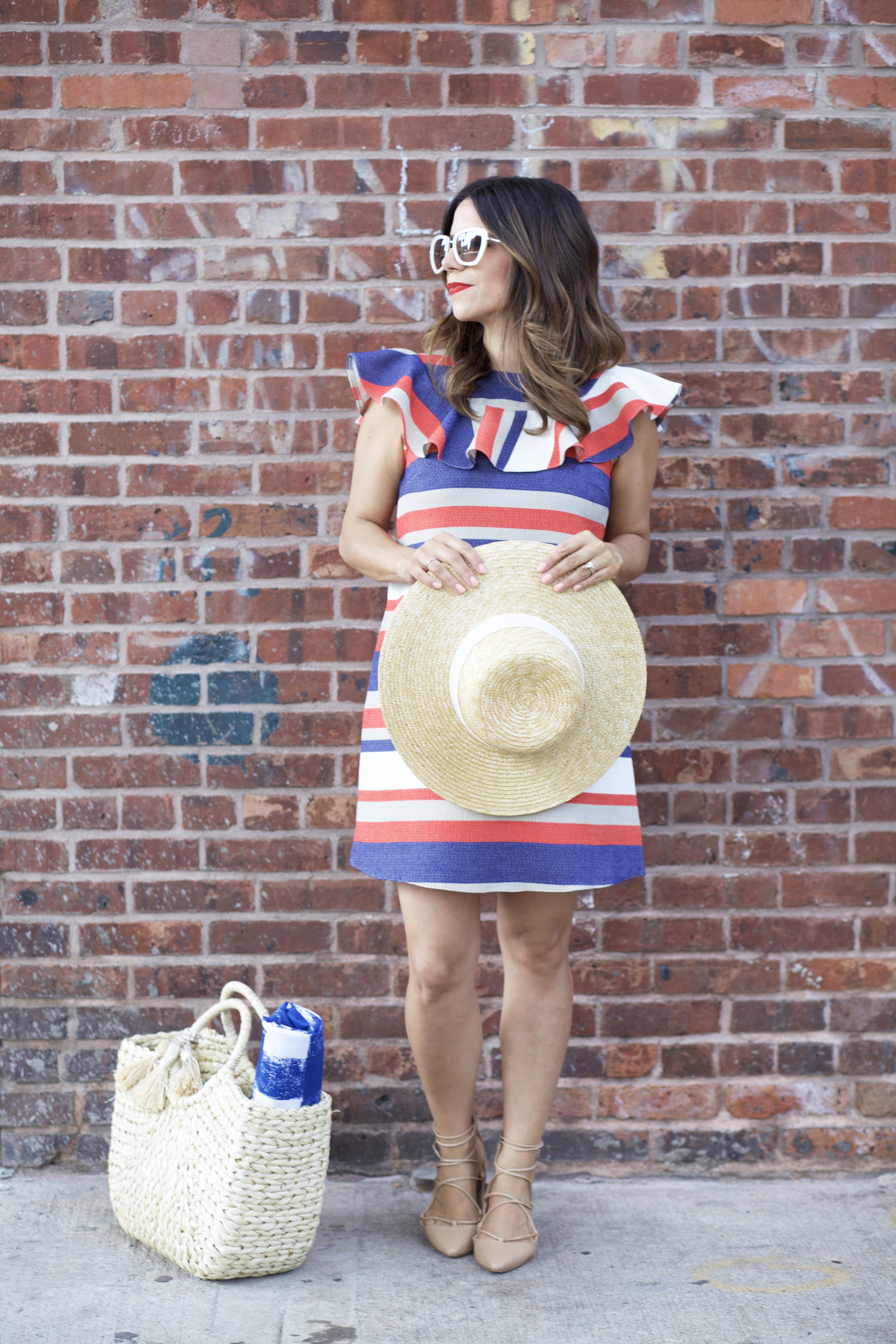 4th of July in New York City DUMBO wearing Red White and Blue dress and straw hat in Summer