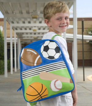 Boy wearing sports backpack