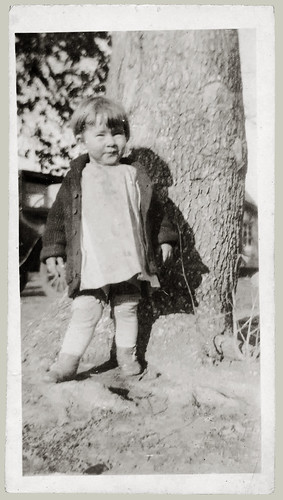 Child by tree
