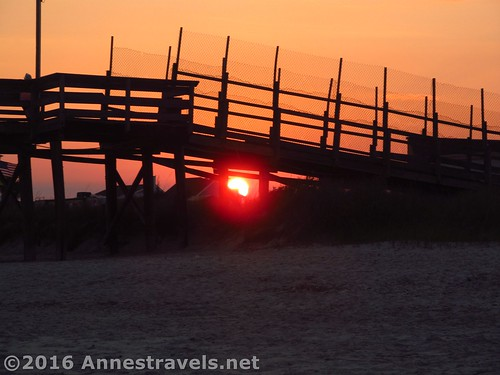 Sunset under the pier on Holden Beach, North Carolina