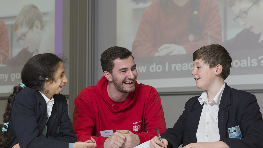 Two students sitting at a table with a Teaching Ambassador during a Futures Day