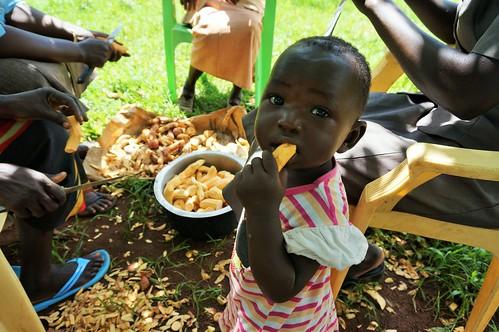 Baby eating sweet potato