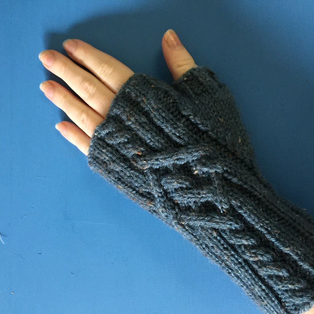 a pair of cabled 'kallan' mitts knitted in a blue, every so slightly tweedy yarn