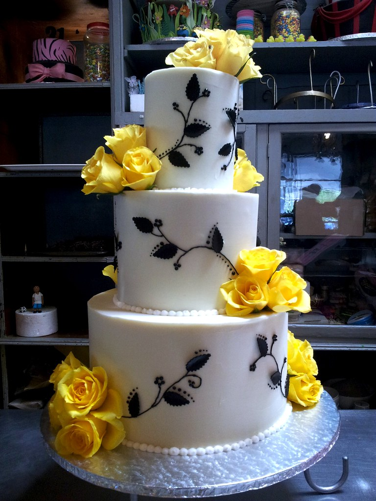 white wedding cake with yellow roses 3 tier wedding cake white ganache icing yellow roses amp pi 27426