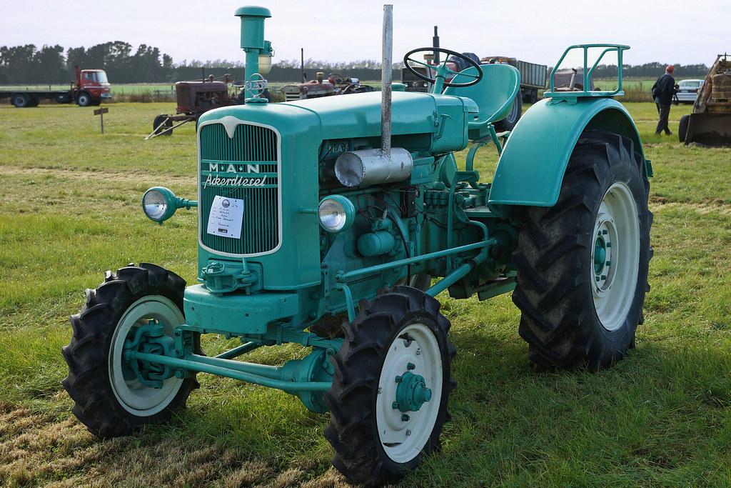 Guy On Tractor : M a n ackerdiesel tractor man mid