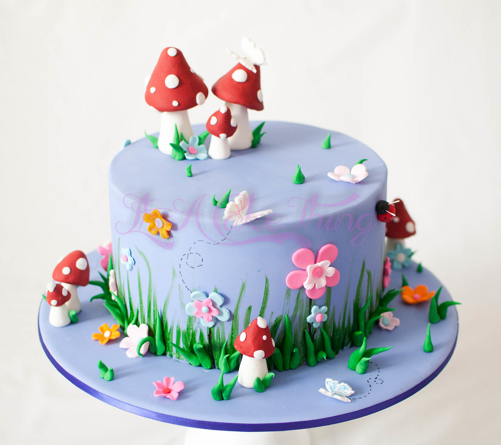 Fairy themed cake 8 chocolate mudcake filled with for Fairy garden birthday cake designs