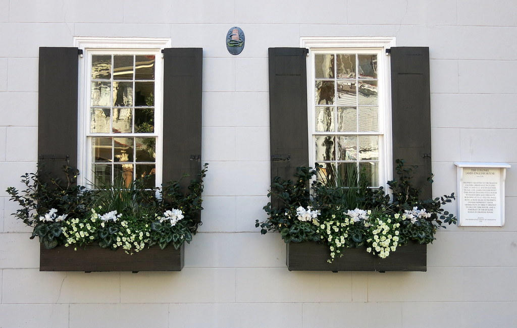 Black Window Boxes Black Shutters An Iron Fire Mark And