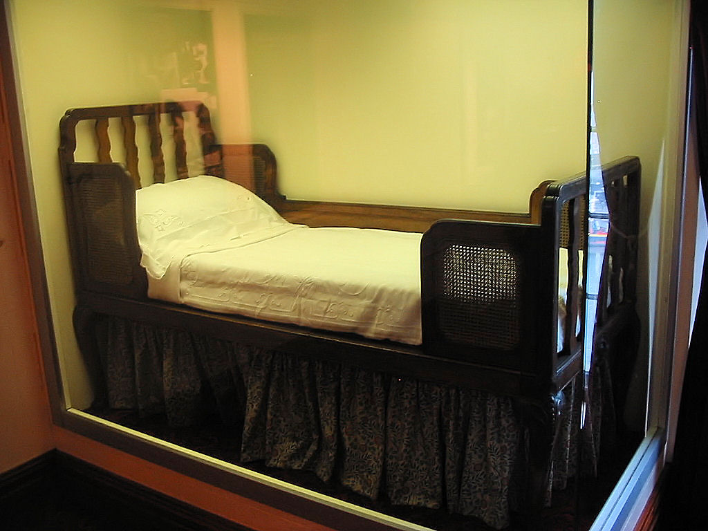 Twin Bed And Crib In Small Room
