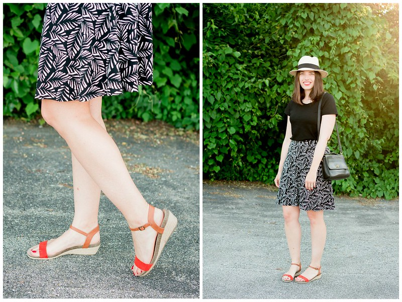 Loft palm leaf skirt + black Target tee + black vintage coach purse + red orange wedges; easy summer outfit | Style On Target