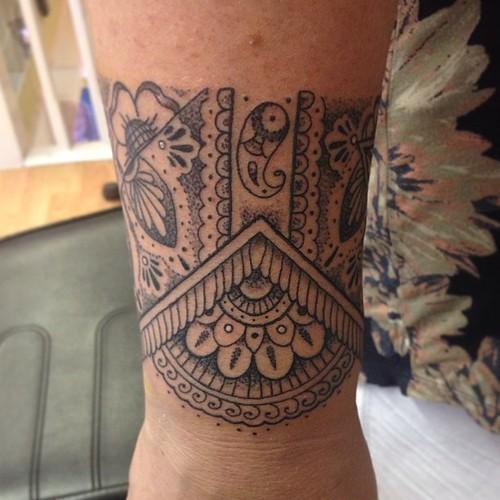Ornamental Bracelet Tattoo On The Left Wrist Tattoo: Front Portion Of A Mehendi Pattern Band Around Wrist