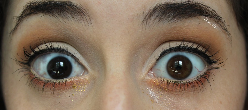 Gold glitter and orange makeup look