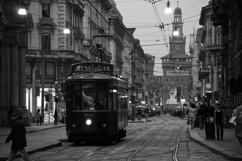 a cool black and white shot of a downtown milan evening