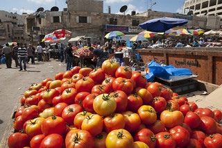 Tomato stand in market near Ramallah's main mosque | by World Bank Photo Collection