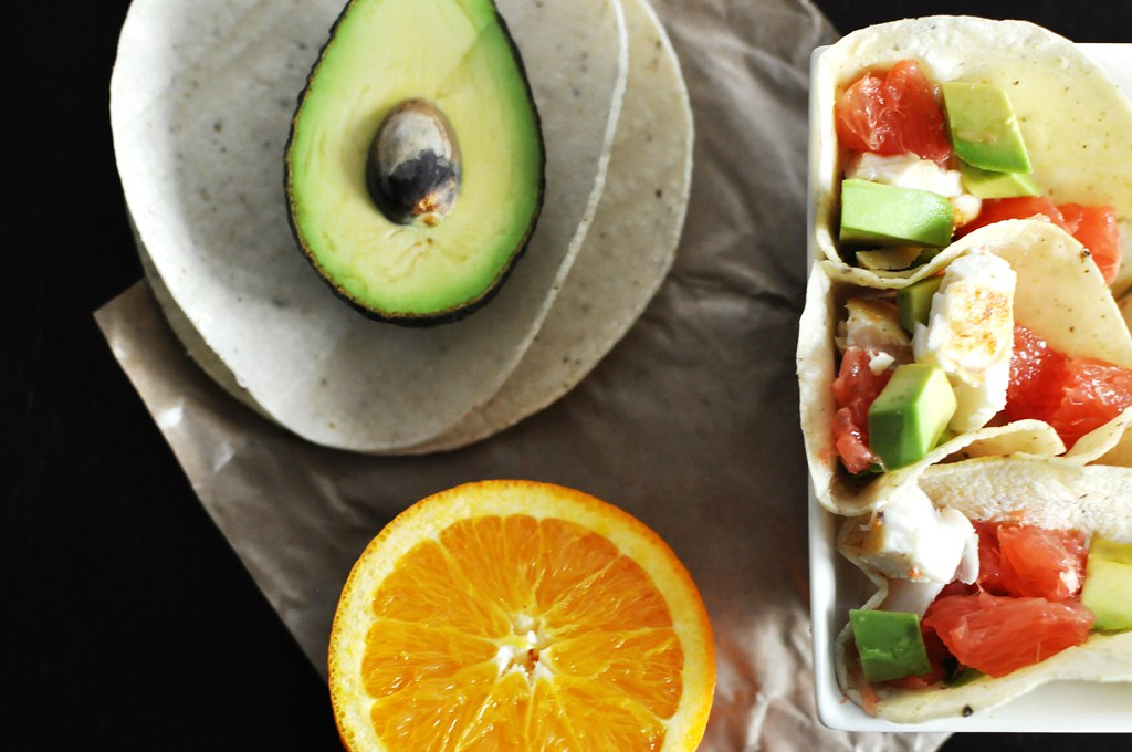 Fish tacos, avocado, and orange