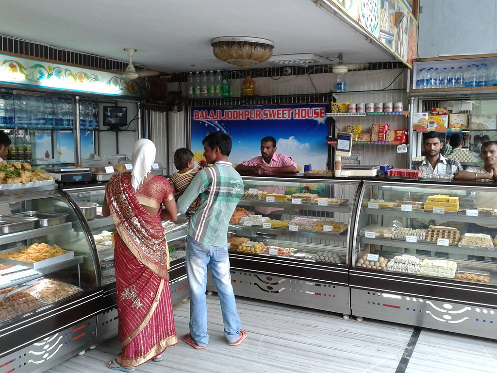 Indian Dairy Sweet Shop Wares And Counter Customers