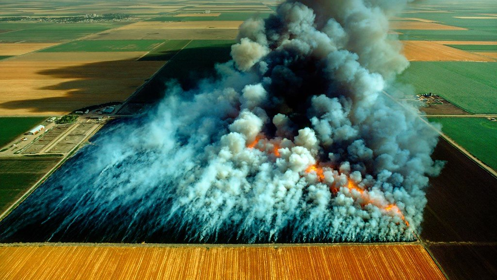 Aerial View Wheat Field Stubble Burn Kansas By Harald S