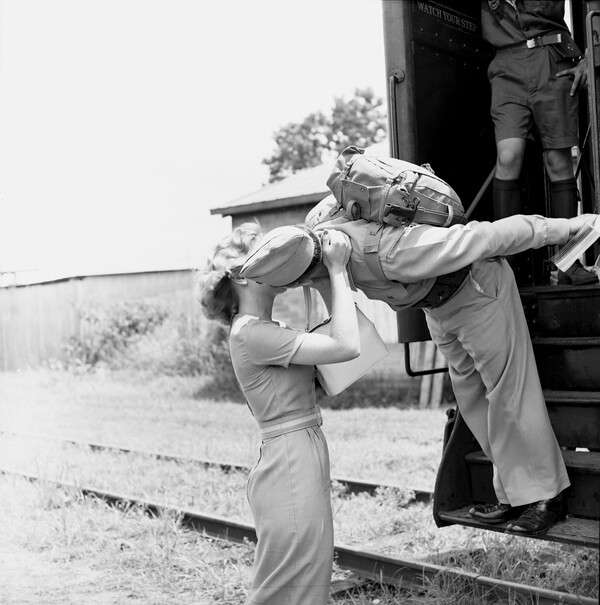 Beth Brown and Marine Corporal Travis Taylor kissing goodbye at the train depot in Tallahassee, Florida