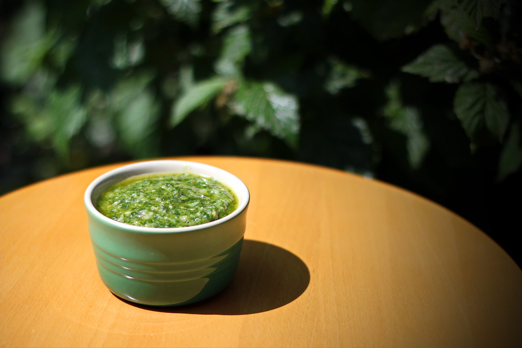 Carrot top pesto on table outside