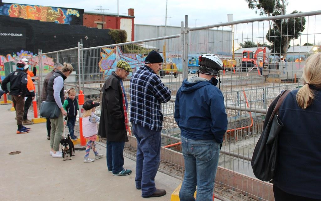Onlookers watch the Mckinnon station works, 28/6/2016