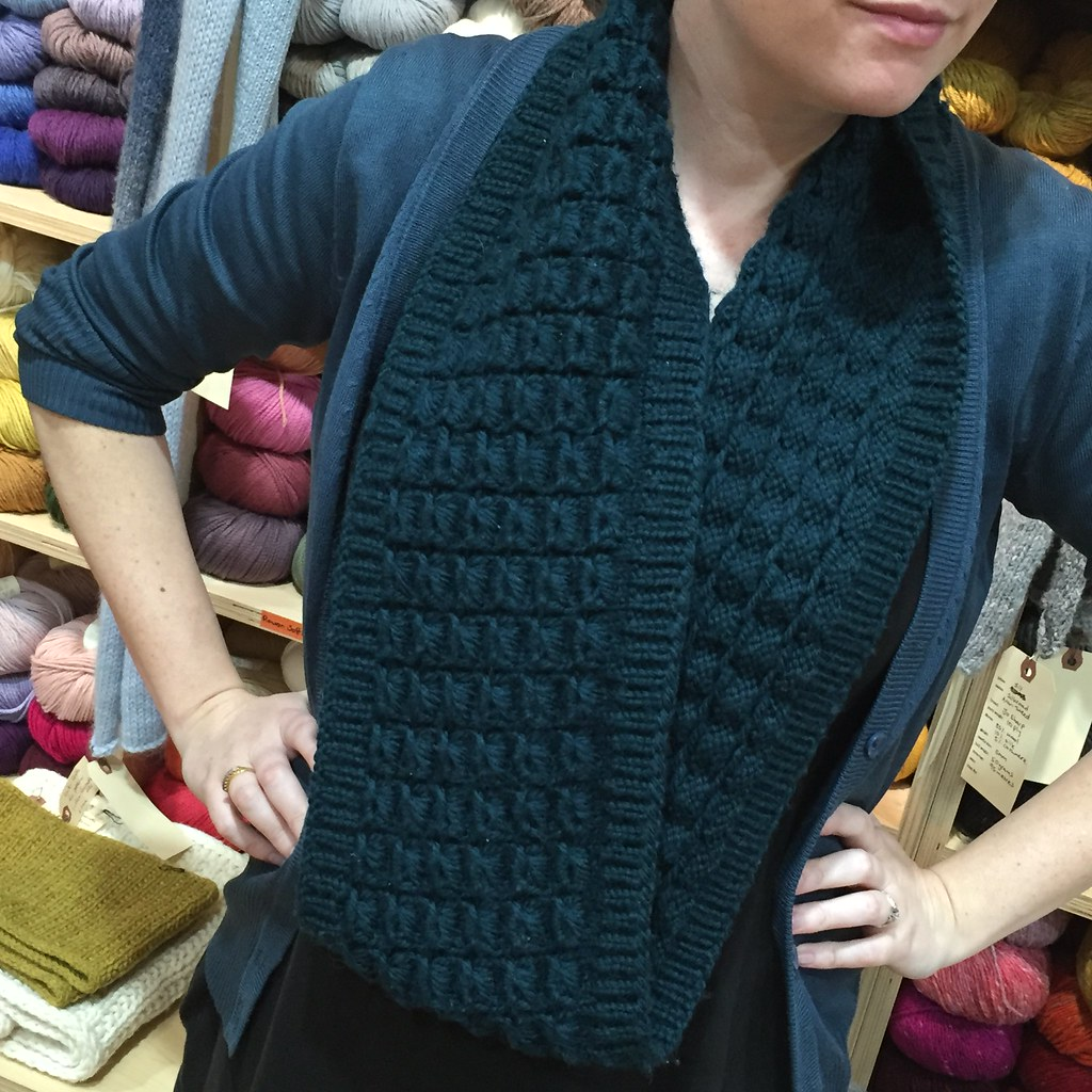 rubus cowl knitted in what may have been a 12ply from the backroom at the bendigo woollen mills in a dark green colour