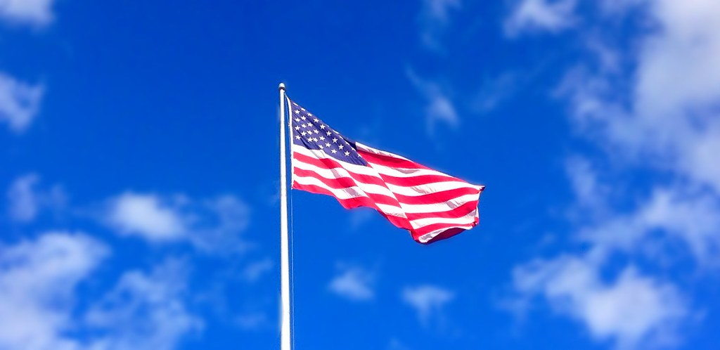 America Flag waving bl...