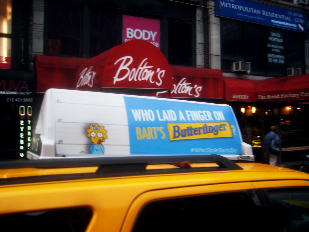 Butterfinger candy bar taxi cab ad baby maggie simpson the for Food bar brecht