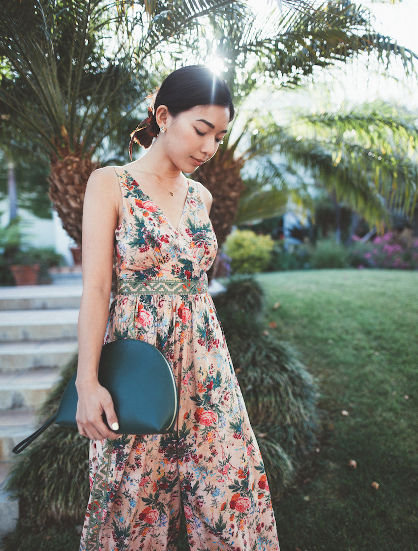 Stephanie Liu of Honey & Silk wearing Plenty by Tracy Reese Jumpsuit, Mansur Gavriel Moon Clutch, and Clarks Sandals