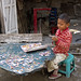 A young boy in Pyinmana Township does a crafts project