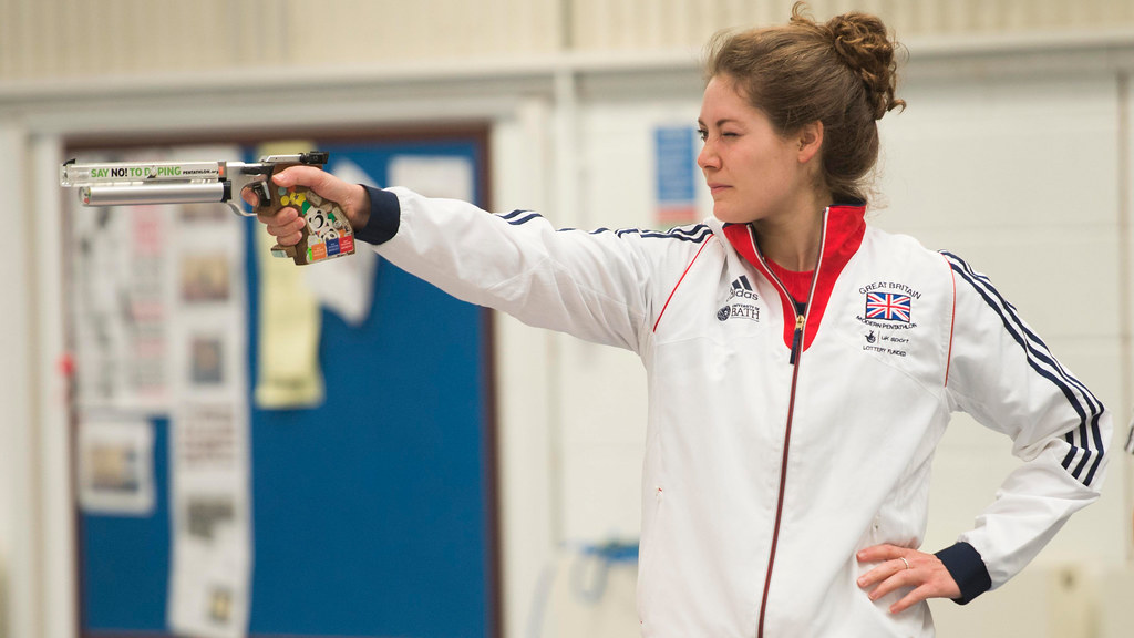 Kate French firing a gun as part of the Modern Pentathlon.