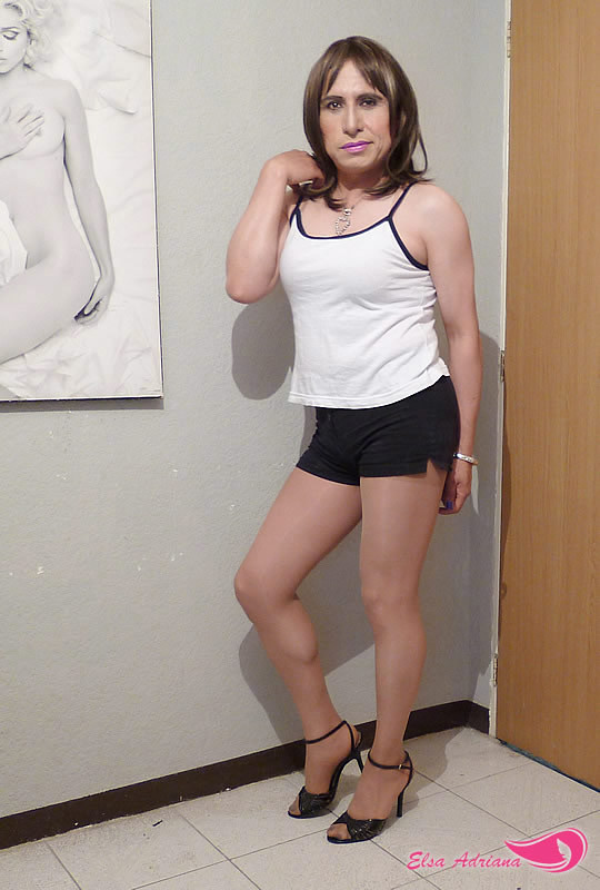 mini black shorts, white blouse and high-heeled sandals ...