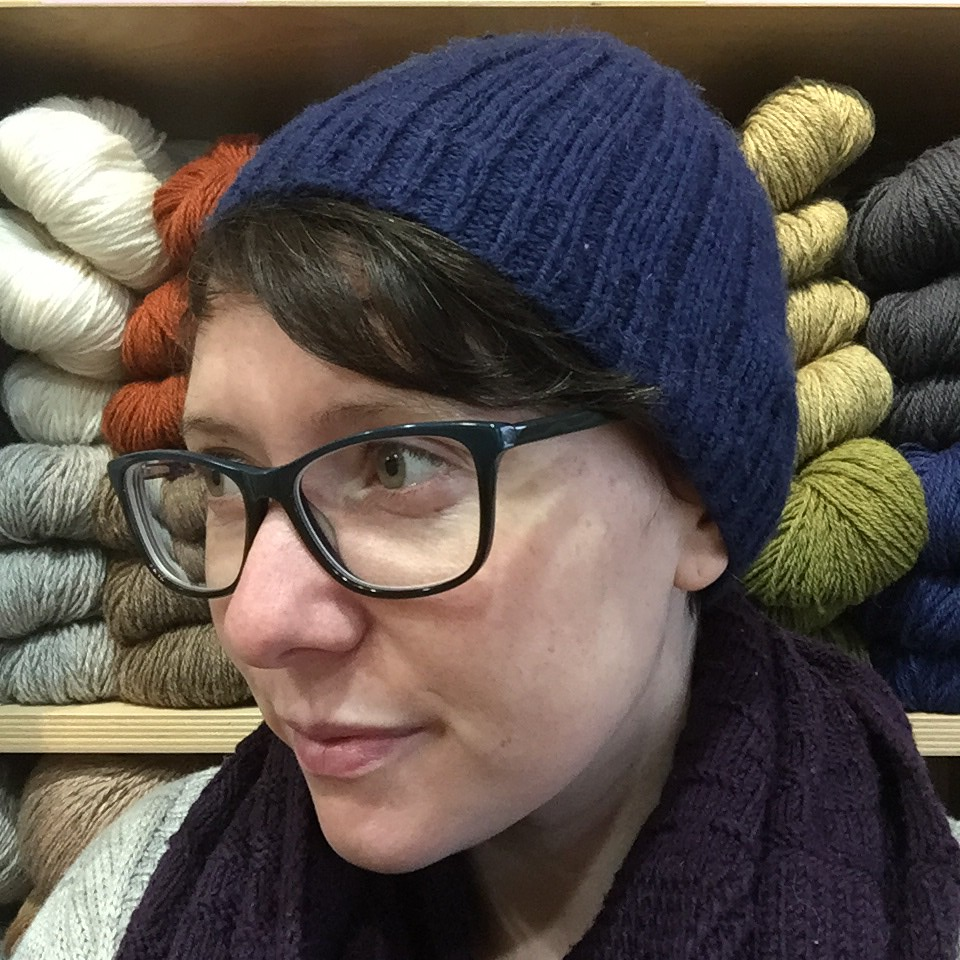 navy ribbed hat, knit to match the aforementioned scarf