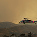 A Navy helicopter helps fight brush fires.