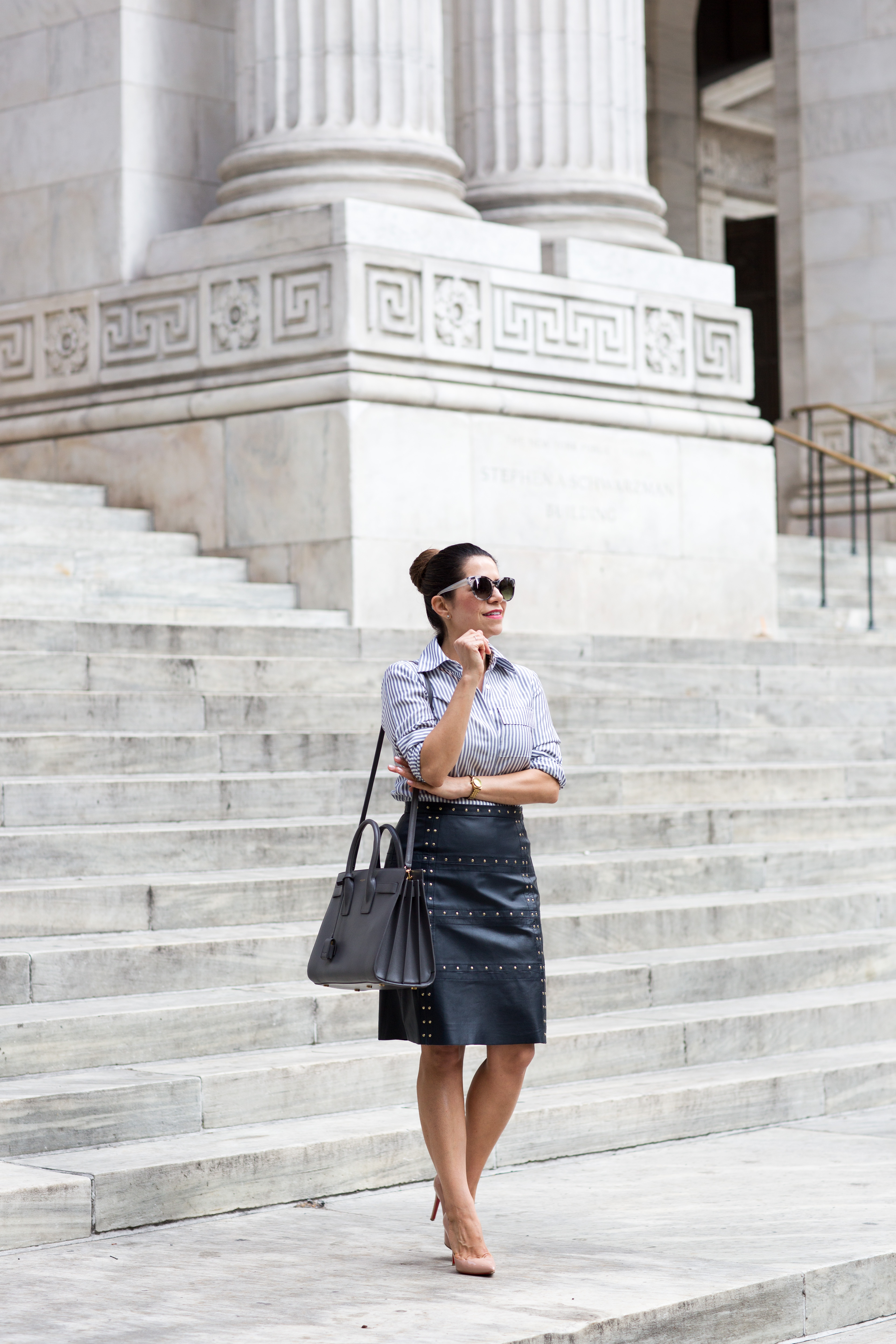 how to wear leather to work leather navy skirt with a stripe button down shirt with worth new york in the spring