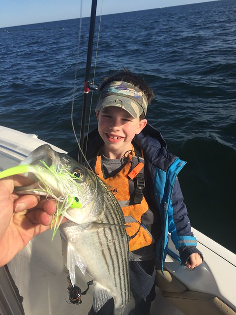 Photo courtesy of Travis Long, holding a striped bass