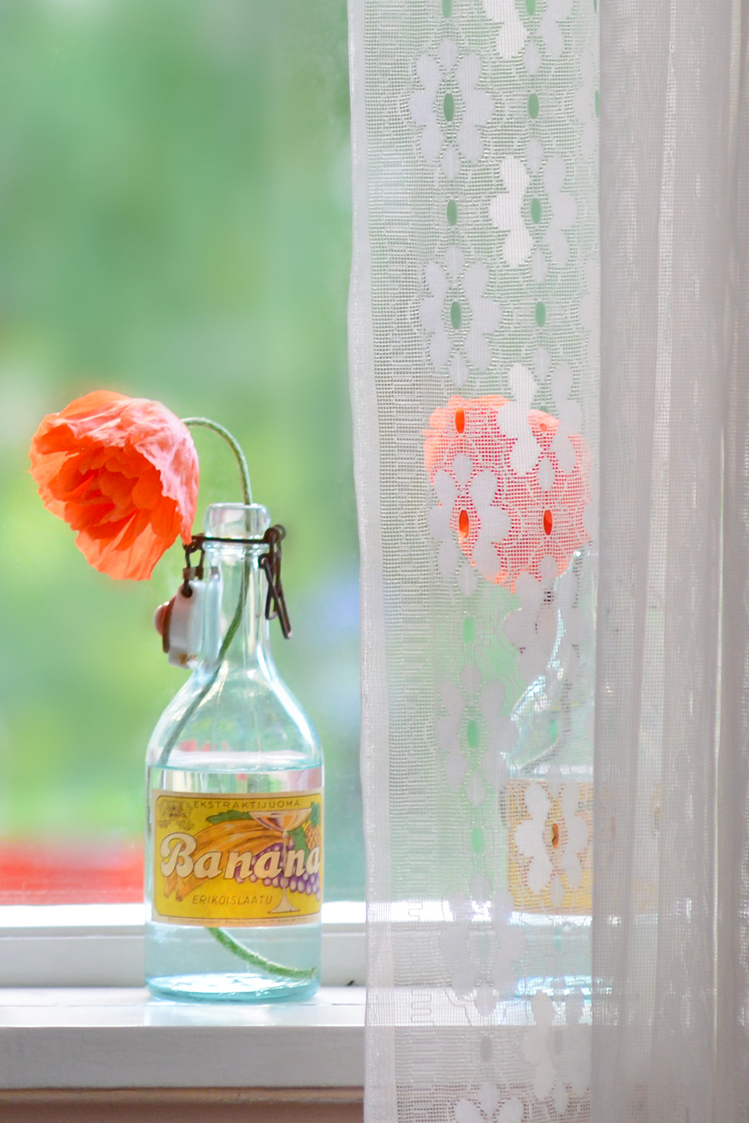 Vintage bottles as flower vases for poppies