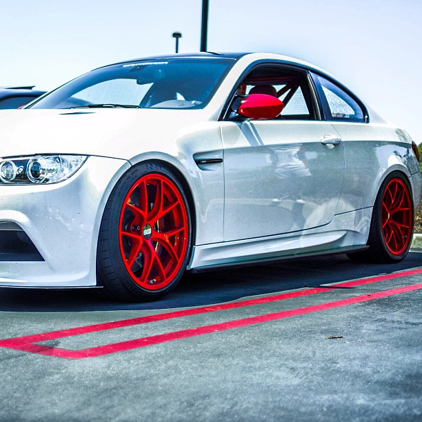 BMW M3 Coupe in pearl white with color-matched molten red wheels and ...