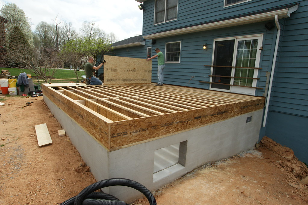 DURING- foundation is complete, the engineered floor joist ...
