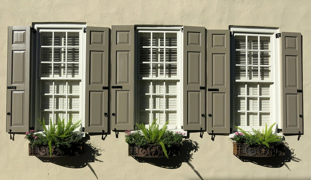 Subtle Shades Of Brown Shutters And Window Boxes In Wroug
