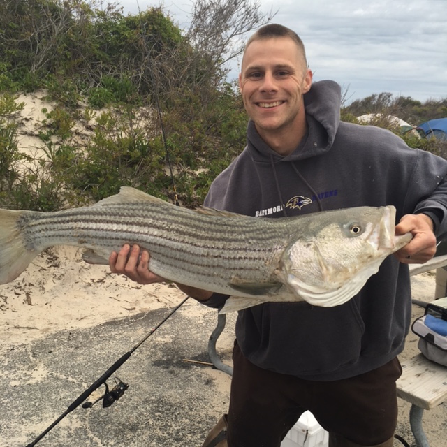Photo courtesy Ray Henry, holding a striped bass
