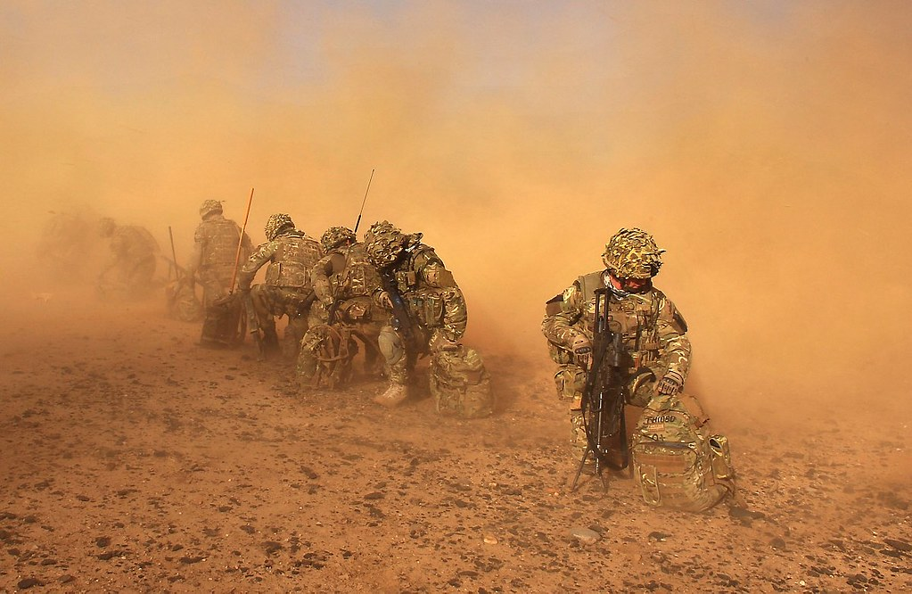 royal marines with 40 cdo engulfed in dust in afghanistan
