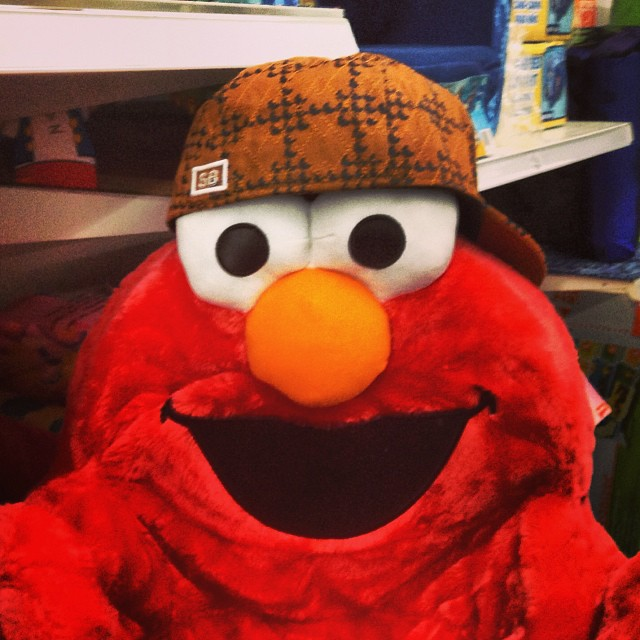 Plush Elmo wearing Scumbag Steve hat